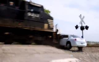 Video: Train slams into beached limo on railway crossing