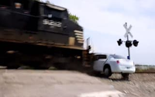 Video: Train slams into beached limo on railway crossing