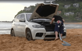 BMW driver taunted by newscaster after beaching his SUV