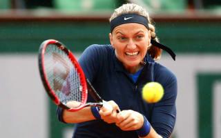 Kvitova avoids shock exit at sodden Roland Garros