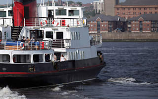 Woman clings to side of ferry for life after boat trip goes wrong