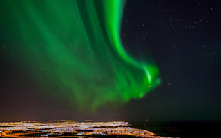 Reykjavik goes dark to show off Northern Lights