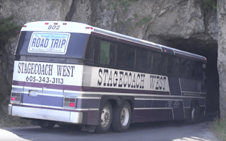 Skilful driver fits bus through incredibly narrow tunnel