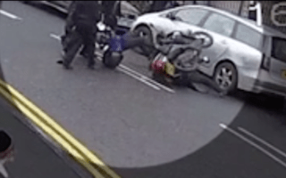 CCTV captures moment traffic warden rides his scooter into group of men