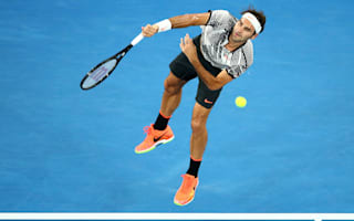 Federer through in four sets on grand slam return