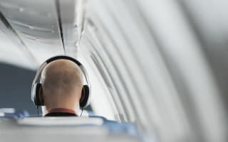 Plane passenger jailed for listening to music on flight