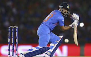 Kohli clinic sends India through and Australia out