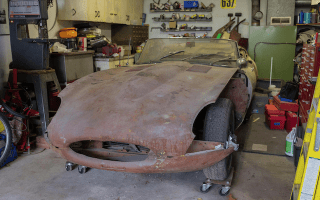 Barn-find Jaguar E-Type makes £37,665 at auction