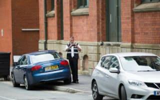 Traffic warden caught parking on pavement...