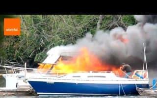 Firefighters rescue people in boat fire