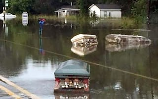 Coffins float in street after Louisiana flooding