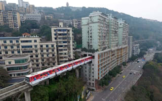Train in China goes right through block of flats