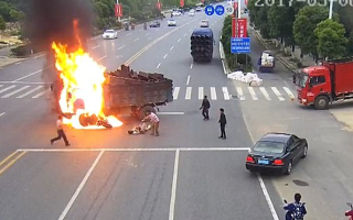 Motorcyclist catches fire after smashing into truck