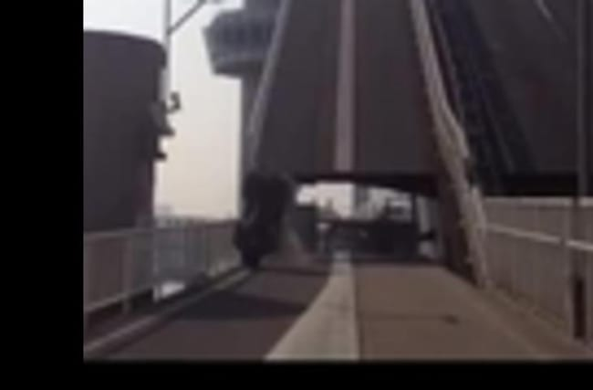 Quad bike rolls off of lifting bridge when it opens