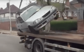 Man tries to drive car off tow truck and fails spectacularly