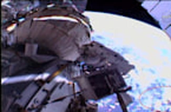 Debris shield floats away during spacewalk