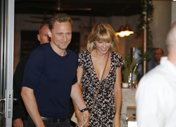 Taylor Swift and Tom Hiddleston share a smooch