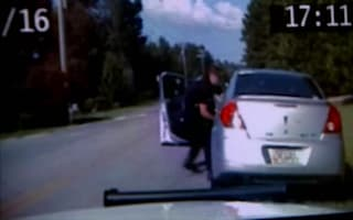 Video captures moment driver runs over policeman's legs