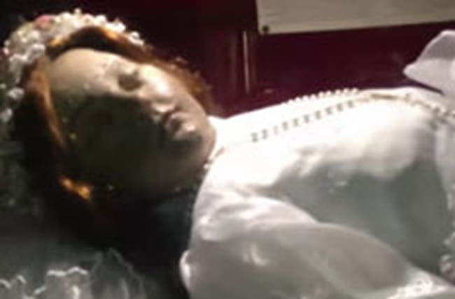 Everyone's going mad as 300-year-old saint 'opens her eyes'