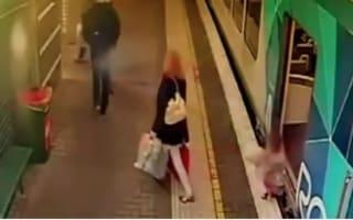 Horrifying moment toddler falls between train and platform (video)