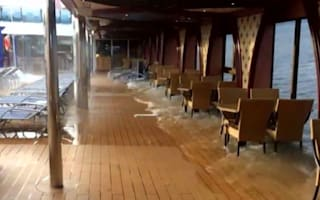 Terrifying moment cruise ship tips dramatically to one side