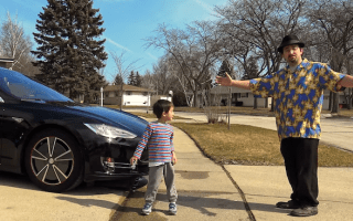 Tesla owner tests car's new autopilot system - on young son