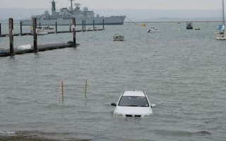 Bungled boat launch sees car roll to watery grave