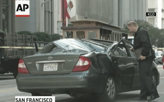 Window cleaner survives fall by landing on moving car