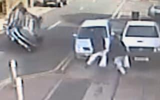 Pedestrians leap to safety as car flips in Blackburn