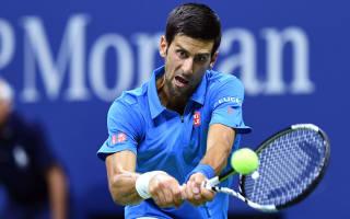 Djokovic overcomes Janowicz despite arm injury