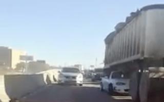 Watch A Mazda MX-5 drive beneath a truck