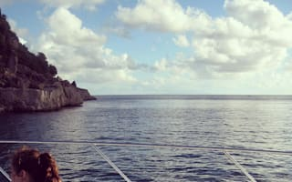 Kelly Brook relaxes on a yacht in her bikini on Caribbean holiday