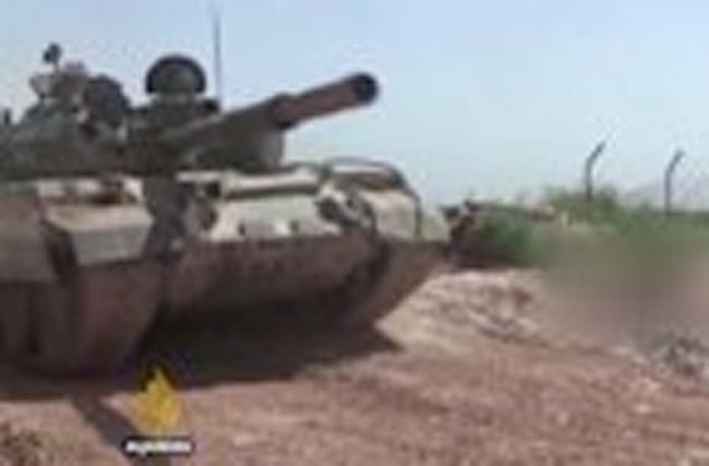 Syrian forces advance on town near Hama