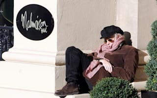 Arise, Sir Bob! Look who's fallen asleep on the steps of luxury hotel