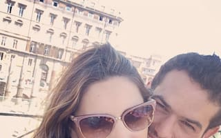 Kelly Brook snuggles up to boyfriend during romantic getaway in Rome