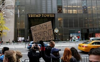Protesters gather on Fifth Avenue as Nigel Farage visits Trump Tower