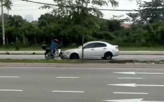 'Robber' drives wrong way down street and hits scooter