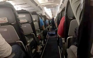 Passengers forced to sit next to dead body for flight