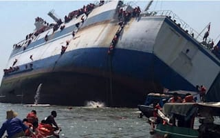Passengers abseil off sinking ferry in Indonesia