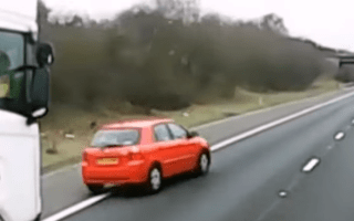 Toyota driver undertakes lorry using hard shoulder on M18
