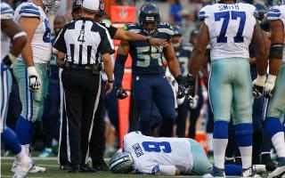 Cowboys QB Romo has broken bone in back