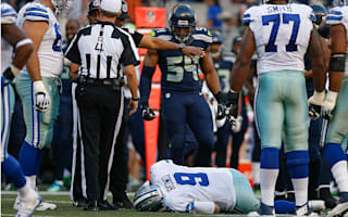 Cowboys QB Romo has broken bone in back