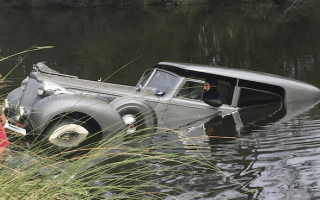 Classic car wins award before rolling into a pond
