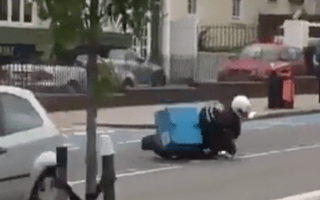 Domino's delivery driver falls off scooter while pulling a wheelie