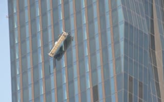 Window cleaners left dangling on 820ft skyscraper: Scary pics