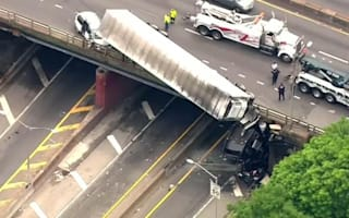 Truck is left dangling off bridge after New York accident