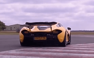 Jay Leno drives McLaren P1 around the Top Gear track