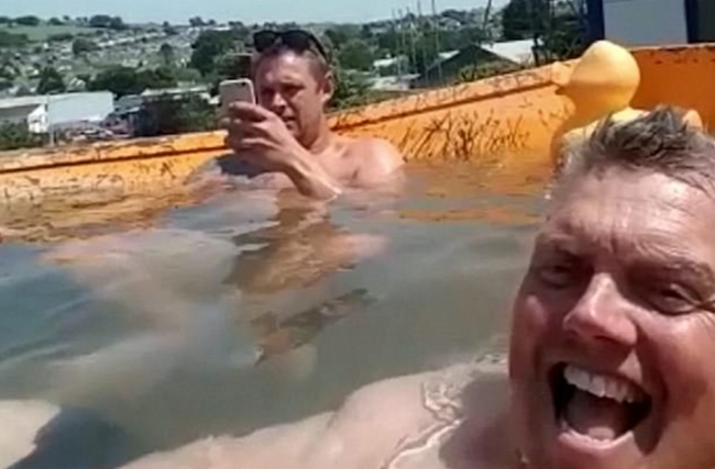 Builders beat the heat by turning dump truck into swimming pool