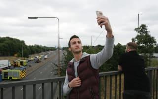 Man takes twisted crash-site selfie
