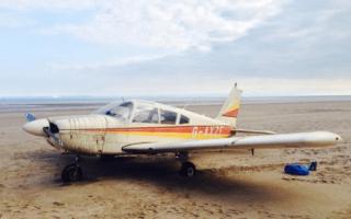 Plane makes crash-landing on beach in Swansea